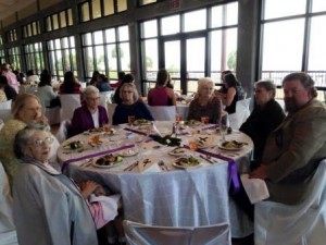 The Sisterhood of Quilters at the Eleventh Annual FavorHouse White Rose Luncheon.